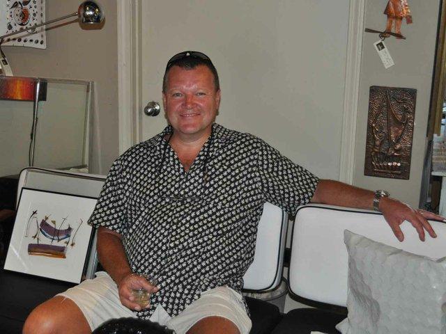Gentleman enjoys Wine Down in SoHo Retro