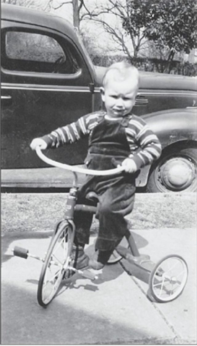 LIFE---Truman-Parrott-riding-a-tricycle-at-his-childhood-home-in-downtown-Homewood----courtesy-of-Howard-Onorato.jpg